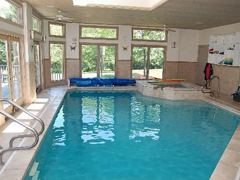 house wow glass encased indoor pool in sprawling ranch