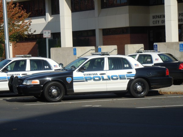 police fire norwalk accused hitting with
