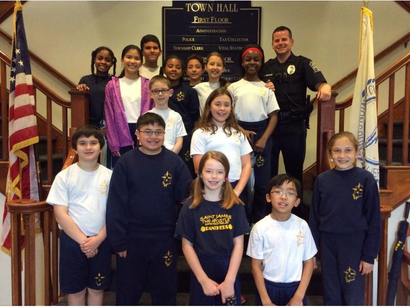 Saint James the Apostle Students Tour Springfield Police Department.