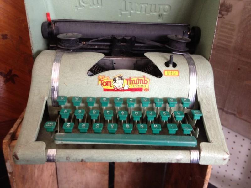 Thumb tom typewriter
