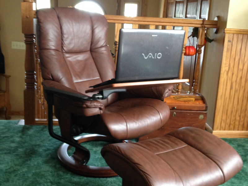 Leather Recliner With Matching Ottoman And Tray Table.