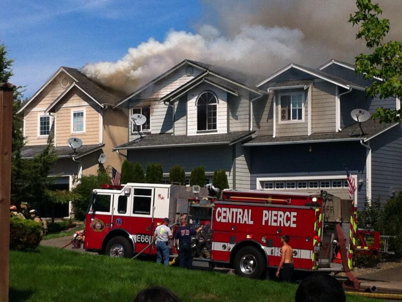 Fire reaches homes in puyallup neighborhood puyallup wa for Home builders in puyallup wa