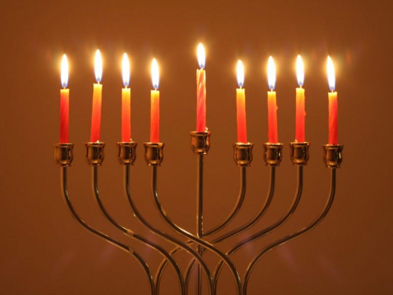 Superb Lighting The Menorah On The First Night Of Hanukkah Photo