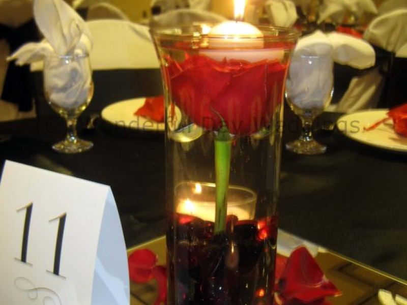 We can't get enough of candle wedding centerpieces. Whether pillars, tapers, votives, or tea lights, there's nothing like a flickering flame to give your wedding reception beautiful ambience.