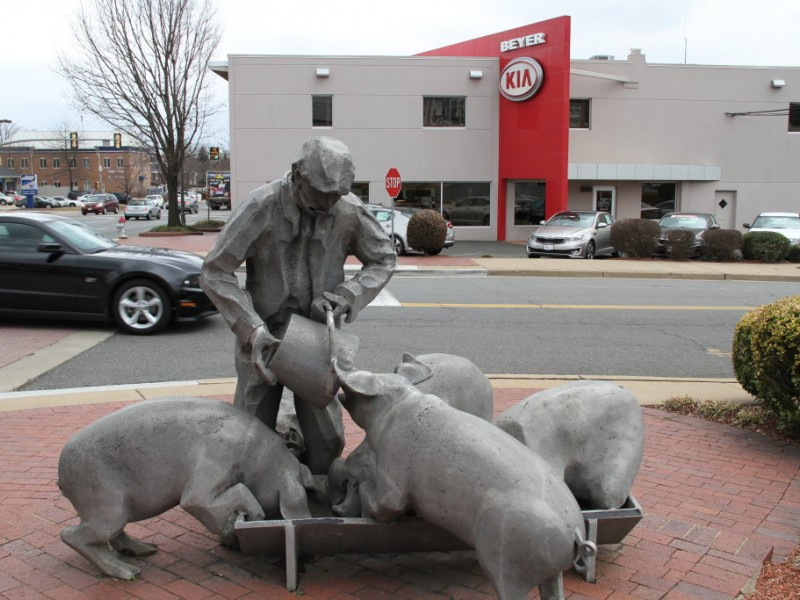 Pigs Still Sizzling Attraction in Front of Don Beyer Volvo | Falls
