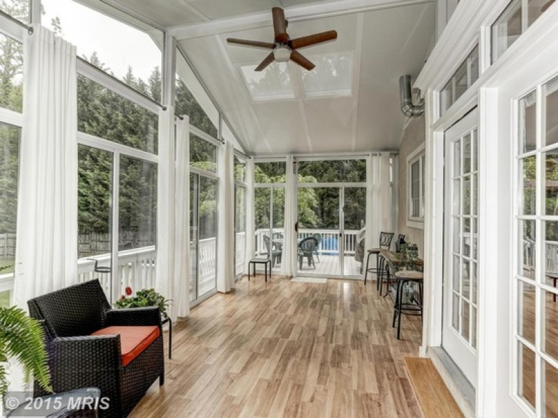 Look inside custom home with sunroom addition 6 for Custom home addition