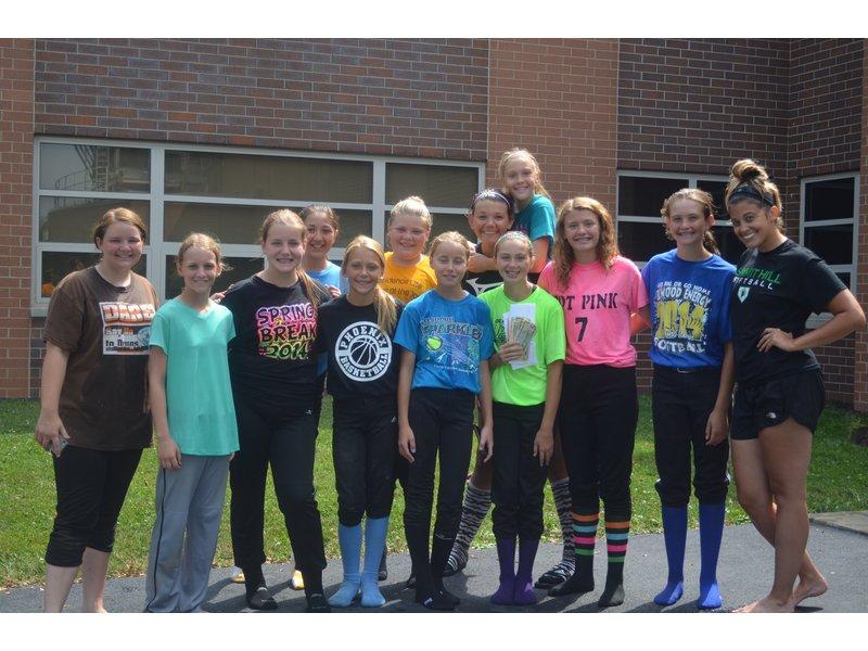 Summit Hill Junior High School Softball Players Score For