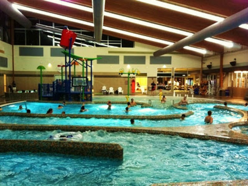 Waterslides in winter the indoor lynnwood pool woodinville wa patch for Swimming pools with waterslides